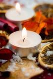 De lichte kaars van de Kerstmisthee Royalty-vrije Stock Afbeeldingen