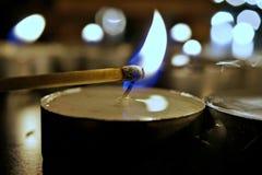 De lichte kaarsen van de verlichtingsthee Stock Foto