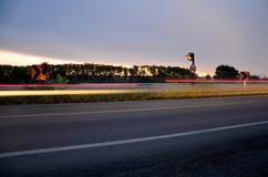De lichte motie blured van auto in ochtend op de weg Royalty-vrije Stock Afbeeldingen