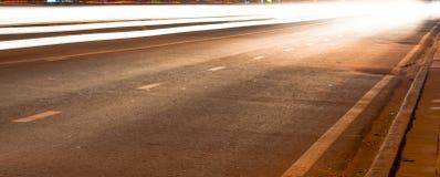 De lichte slepen op de straat Stock Foto's
