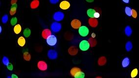 De lichten van Bokeh Mooie Kerstmisachtergrond Kerstmis en Nieuwjaar Kerstmis lichte Feestelijke samenvatting als achtergrond stock video