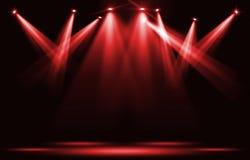 De lichten van het stadium Rode schijnwerperstaking door de duisternis Stock Fotografie