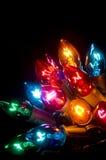 De Lichten van Kerstmis op Zwarte Stock Foto