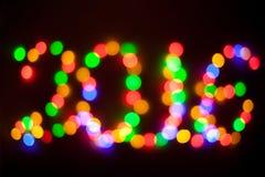 De lichten van Kerstmis van Defocused Nieuwjaar 2016 bokeh Samenvatting Stock Afbeeldingen