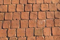 De lichtrode textuur van de steenbaksteen Royalty-vrije Stock Foto