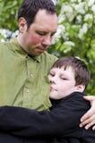 De liefde van de vader en van het jonge geitje Royalty-vrije Stock Afbeelding
