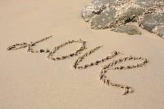 De LIEFDE van Word op het strand Stock Afbeeldingen