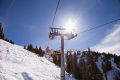 De lift van de skistoel van Alpen in Oostenrijk Stock Foto's