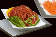 Groene paprika's en wortelen, Plak van voedsel, Royalty-vrije Stock Foto