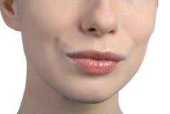 De lippen van de vrouw het kussen Stock Afbeelding