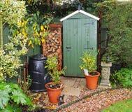 De Loods van de tuin met logboekopslag Royalty-vrije Stock Foto