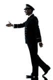 De lucht proef eenvormige silhouet van de mens het lopen handdruk Royalty-vrije Stock Foto