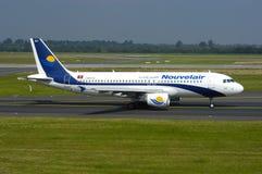 De Luchtbus van Tunisie van Nouvelair A320 stock foto's