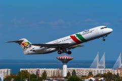 De Luchtvaartlijnenfokker 100 van PGA Portugalia Stock Fotografie