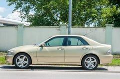 De luxe Lexus IS 220 HDi auto op de straat wordt geparkeerd die Stock Foto's