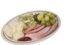 De maaltijd van de Ham van het braadstuk op een plaatisol stock foto