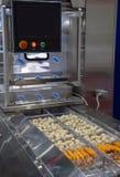 De machine van de voedselverpakking stock afbeeldingen