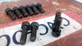 De machinebouten in zwarte kleur sluiten omhoog Stock Afbeelding
