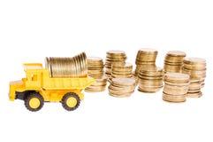 De machines van de bouw over heel wat gouden muntstukken Stock Afbeelding
