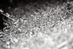 De macroachtergrond van staalspaanders Royalty-vrije Stock Afbeeldingen
