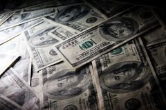 De macrofoto van de schijnwerper van $100 rekeningen. Stock Fotografie