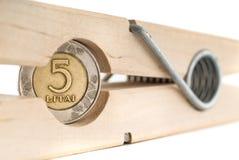 De madeira vista a rotação com uma moeda nela Imagem de Stock