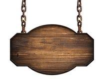 De madera firme adentro la ejecución de madera oscura en una cadena aislada Fotos de archivo libres de regalías