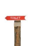 De madera permita la muestra del retrete del indicador para el fondo o el texto en blanco foto de archivo