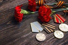 9 de maio fundo Medalhas da grande guerra patriótica, reforço do ` s de St George Imagens de Stock Royalty Free