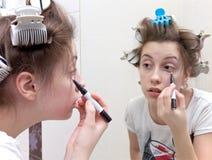 De make-up van de tiener stock afbeeldingen