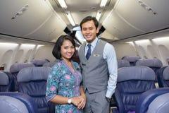 De Maleise leden van de Luchtvaartlijnbemanning stock afbeelding