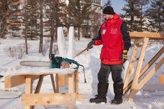 De man doet de vlinder van sneeuw Royalty-vrije Stock Foto's
