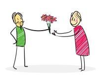De man geeft bloemen aan een vrouw Stock Foto's