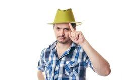 De man met een varkenshaar in groen een hoed Stock Afbeeldingen