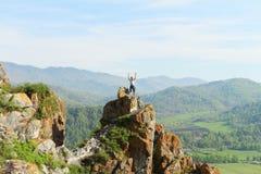 De man op de rots Stock Foto