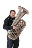 De man speelt een tuba Stock Afbeelding
