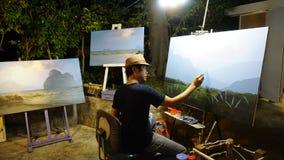 De man trekt het beeld op acrylcanvas Stock Afbeelding