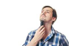 De man verkort een baard de snoeischaar Stock Afbeeldingen