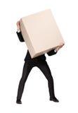 De manager draagt een reusachtig pakket stock foto