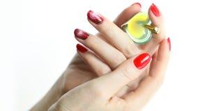 De manicure van de spijkerkunst met hart Stock Foto's