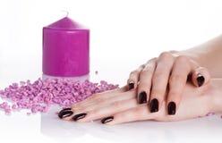 De manicure van het kuuroord met aromakaars Royalty-vrije Stock Foto