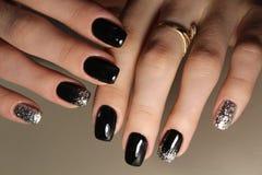 de manicureontwerp van de manier zwart en gouden kleur Royalty-vrije Stock Fotografie