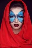 De manier maakt omhoog. De make-up van de vlinder op gezichts mooie vrouw. Kunst P stock foto's