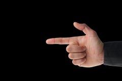 De mannelijke hand die van Caucasion een kanon maakt op zwarte ondertekenen royalty-vrije stock fotografie