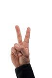 De mannelijke hand die van Caucasion een vredesteken maakt royalty-vrije stock fotografie
