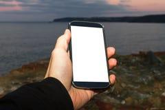 De mannelijke Slimme Telefoon van de Handholding op Avond Stock Afbeeldingen