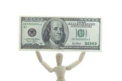 De mannequin houdt dollarrekening hoog omhoog Royalty-vrije Stock Afbeeldingen