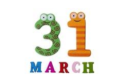 31 de março no fundo, nos números e nas letras brancos Imagem de Stock