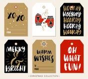 De markering van de Kerstmisgift met kalligrafie Hand getrokken ontwerpelementen Stock Foto