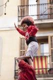 22 de marzo de 2015 Niña en el top del castillo humano castellers Fotografía de archivo libre de regalías